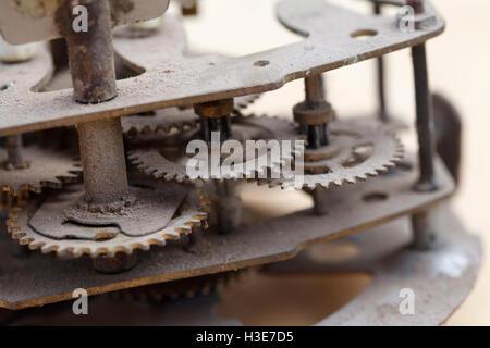 Old clockwork close-up, vintage background of dusty mechanism - Stock Photo