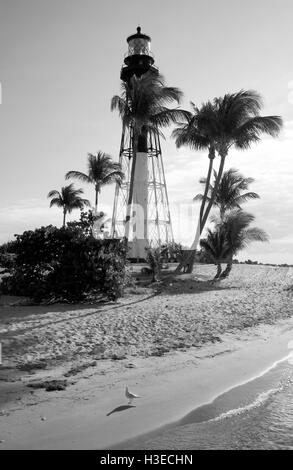 In this black and white image of the Hillsboro Lighthouse early morning sun from the east casts long shadows of - Stock Photo