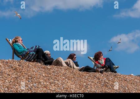 Brighton beach on sunny spring afternoon - Stock Photo