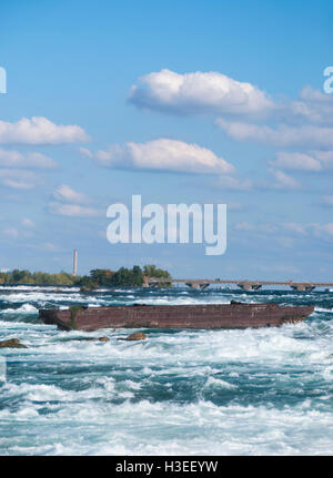 Old barge-scow stuck on the rocks above Niagara Falls since 1918.