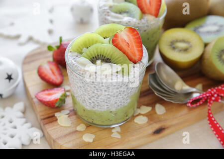 Homemade chia seed pudding with kiwi and strawberry, Christmas breakfast - Stock Photo