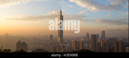 Taipei, Taiwan - January 5, 2015: Panoramic view of Taipei city skyline during sunset - Stock Photo