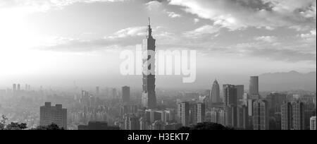 Taipei, Taiwan - January 5, 2015: Black and white panoramic view of Taipei city skyline during sunset - Stock Photo