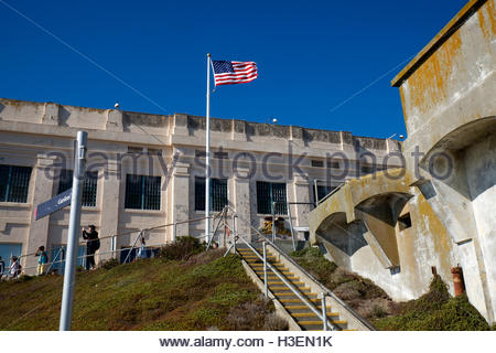 A United States Flag flies from a pole outside Alcatraz Federal Penitentiary in San Francisco, California. - Stock Photo