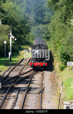 A Q6 Restored Steam Engine 63395 Pulling a Passenger Train into Goathland Station on the North Yorkshire Moors Railway - Stock Photo