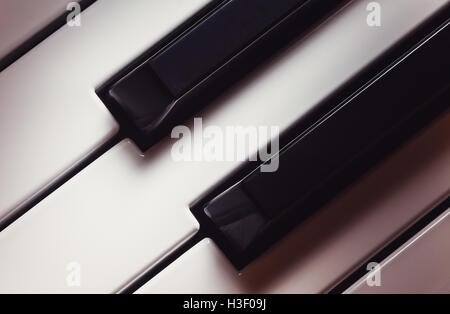 Details of a modern synthesizer keys, closeup view. - Stock Photo