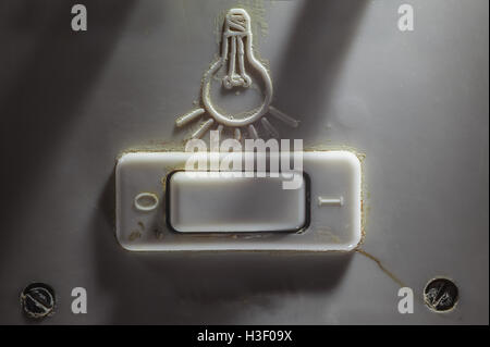 Details of an old dirty plastic switch for turning light on or off. - Stock Photo