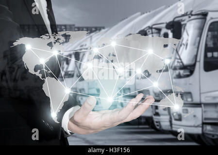 Global logistics network map on hand of businessman, container cargo for Logistic Import Export background (Elements - Stock Photo