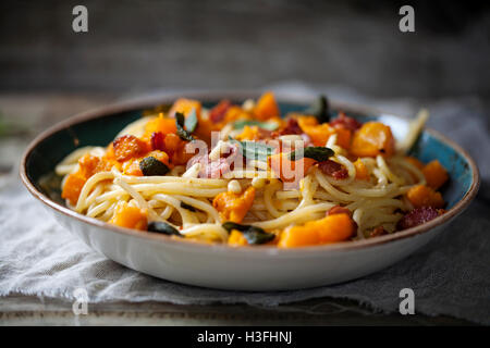 Spaghetti with roast butternut squash and sage - Stock Photo