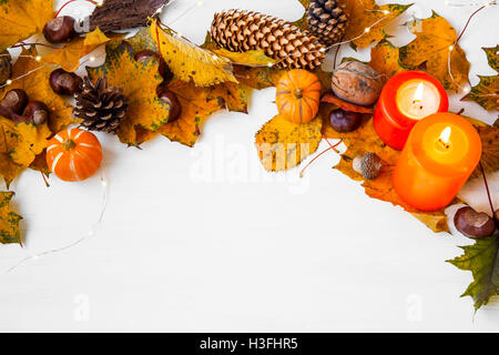 Autumn frame decoration with leaves,acorns, chestnuts, pine cones,pumpkins, candles - Stock Photo