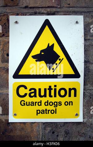 Caution GUARD DOG PATROL ! warning sign - Stock Photo