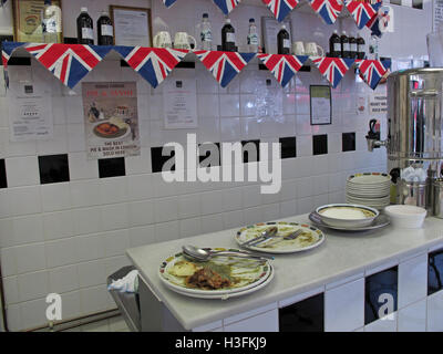 Inside Robins traditional Pie & Mash, Ilford Essex, Greater London, England, dirty plates - Stock Photo