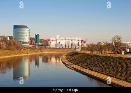 Vilnius, Lithuania - March 16, 2015: Lithuanian University of Educational Sciences and a modern building of Barclays - Stock Photo