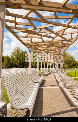 Benches near Komsomolskoye lake in Victory park in Minsk, Belarus - Stock Photo