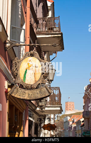 Vilnius, Lithuania - March 18, 2015: Cafe sign on the street of the old town in Vilnius. - Stock Photo