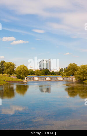 Minsk, Belarus - June 18, 2015: Modern building of National library of Belarus, view from the beautiful park on - Stock Photo