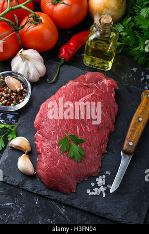 Raw fresh beef steak and vegetable. Selective focus - Stock Photo