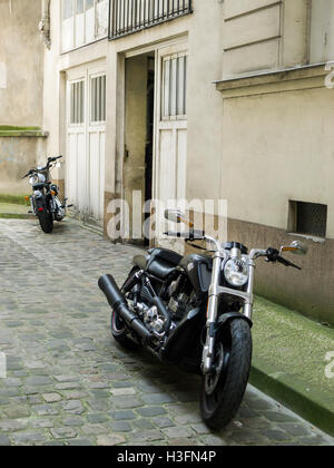 Two powerful motorbikes (Harley Davidson in foreground) parked in Paris, France - Stock Photo