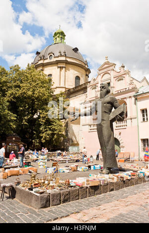 Lviv, Ukraine - July 10, 2015: Book market near monument to Ivan Fedorov, one of the founders of Eastern Slavonic - Stock Photo