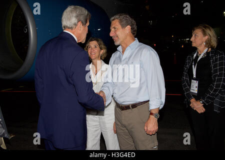 U.S. Secretary of State John Kerry, watched by Colombian Vice Minister of Foreign Affairs Patricia Londono, shakes - Stock Photo