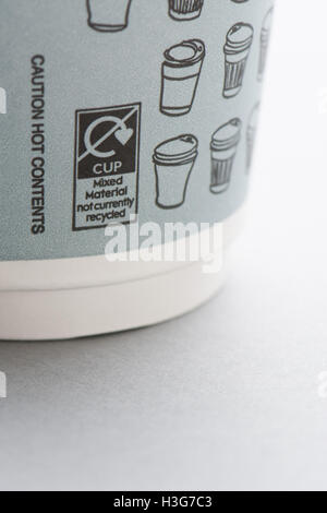 close up of 'mixed material not currently recycled' labelling on disposable paper takeaway coffee cup from Waitrose - Stock Photo
