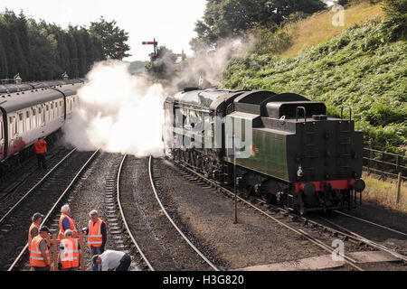 'Sir Keith Park' locomotive on the Severn Valley Railway and working engineers on the railway line. - Stock Photo