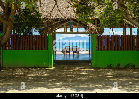 Beachside restaurant near Areia Branca, Dili, Timor Leste, with view of Atauro Island - Stock Photo