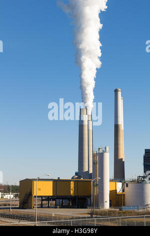 Smoke billows from one of the stacks at the Belews coal power plant in Stokes County NC. - Stock Photo