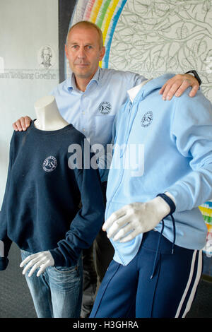 Contwig, Germany. 07th Oct, 2016. Headmaster Thomas Hoechst standing between two dummies dressed in clothes bearing - Stock Photo