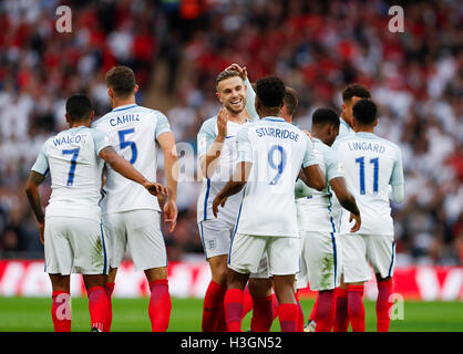 London, UK. 8th Oct, 2016. Daniel Sturridge (4th, L) celebrates his goal with his teammates during the Group F match - Stock Photo