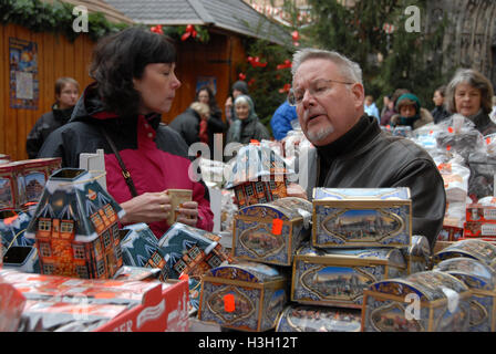 Visitors shopping for the famous Nuremberg ginger bread at the Christmas market.  The Nuremberg Christmas Market - Stock Photo