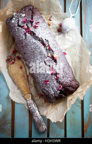 Homemade chocolate banana loaf with dried roses - Stock Photo