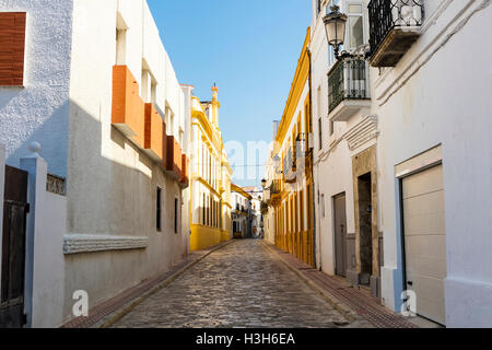Narrow cobbled street in an old Spanish town. - Stock Photo