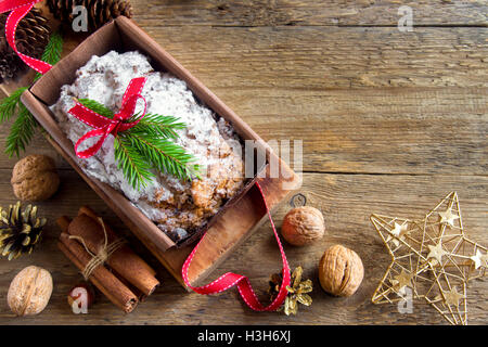 Traditional fruitcake for Christmas with decoration and ornaments - homemade festive Christmas pasrty - Stock Photo