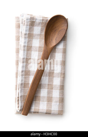 Handmade wooden spoon on checkered napkin. Top view. - Stock Photo
