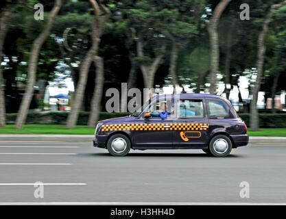 BAKU, AZERBAIJAN - SEPTEMBER 25: Cab taxi in the street of Baku on September 25, 2016. Baku is a capital and largest - Stock Photo
