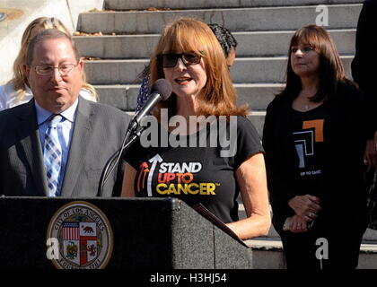 Paul Koretz and Marg Helgenberger attends Press Conference For 'Stand Up To Cancer Day' at Los Angeles City Hall, - Stock Photo