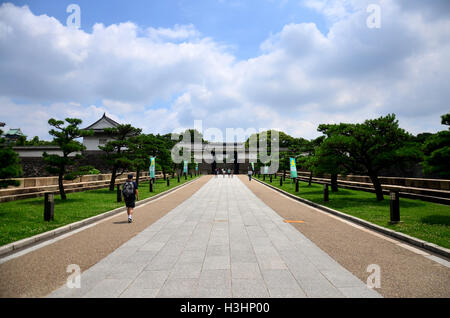 Japanese people and traveler foreigner walking to inside Osaka castle travel and visit Osaka castle at Kansai region - Stock Photo