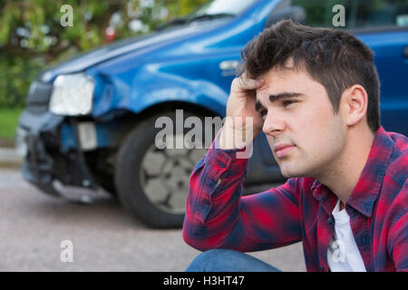 Unhappy Driver With Damaged Car After Accident - Stock Photo