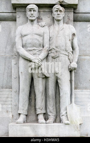 Figures on the Memorial to the Engine Room Heroes of the Titanic.  The visible damage is from shrapnel in World - Stock Photo