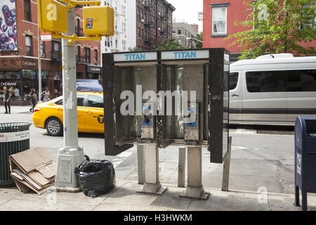 You can still find coin operated pay phones here and there on the streets of Manhattan, NYC. - Stock Photo
