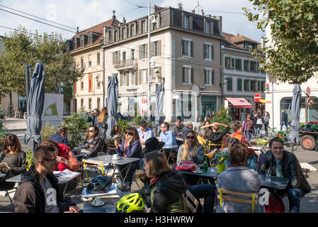 People sitting in a street cafe, Place du Marche in Carouge, Geneva, Switzerland - Stock Photo