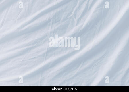 Crumpled Bed Sheets Texture As Background, Top View   Stock Photo
