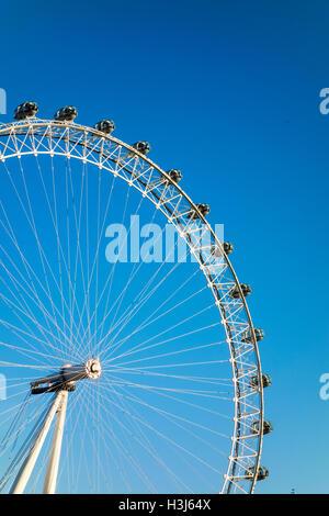 London Eye against a blue sky - Stock Photo