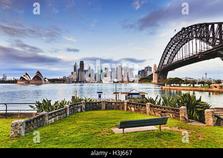 Green grass and bench in recreational park zone of Kirribilli suburb of Sydney across harbour from the city major - Stock Photo