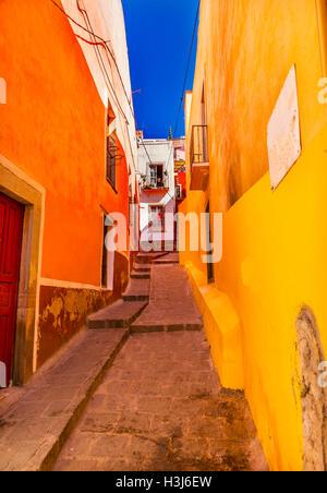 Yellow Orange Narrow Street Guanajuato Mexico - Stock Photo