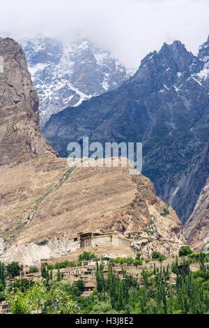 Baltit fort in mountains background, Karimabad, Hunza Valley, Gilgit Baltistan region, Pakistan - Stock Photo