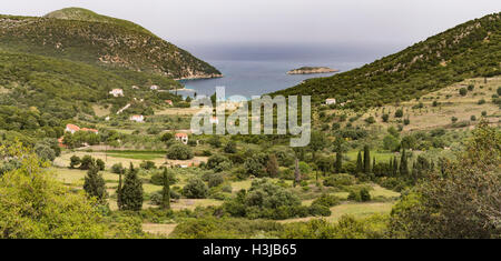 Atheras, Kefalonia surrounded by a beautiful landscape of olive tree covered hills and sea. - Stock Photo