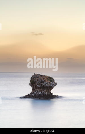 Unusual rocks stand out of the sea at Poros, Kefalonia. - Stock Photo
