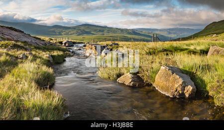 Nant Gwryd flows from Llyn Cwmffynnon leading into Dyffryn Mymbyr, Snowdonia. - Stock Photo